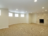 Entertainment room: Curved wall with real marble fireplace